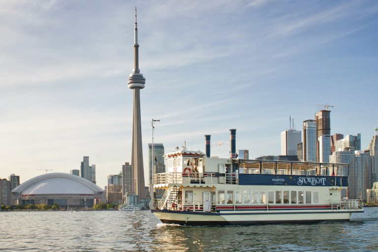 Showboat with Toronto Harbour skyline with CN Tower and Rogers Center behind.