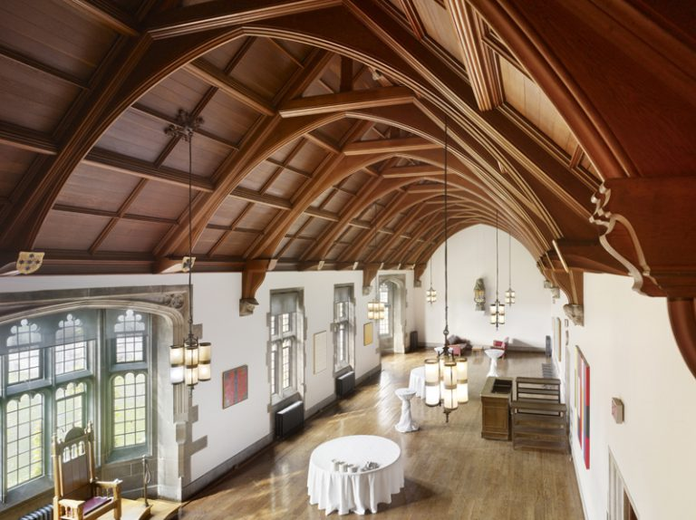 Debates room at Hart House, with high wood vaulted ceilings, wood floors. View is from above.