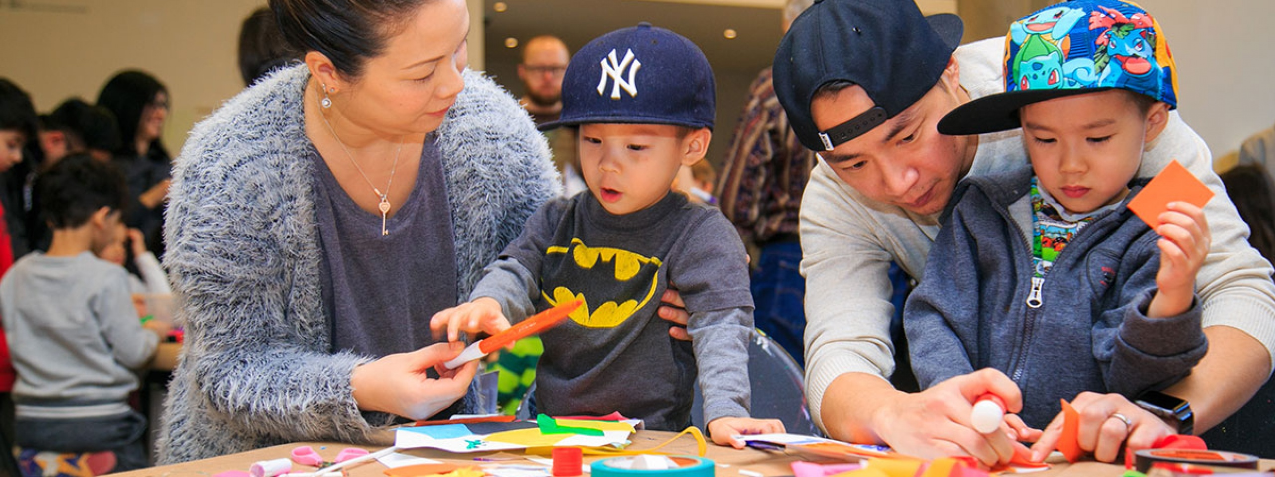 Parents help their kids with crafts at the AGO.