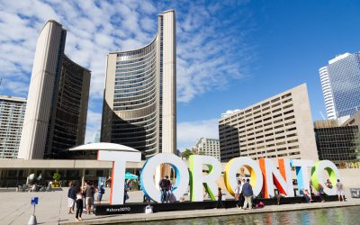 Nathan Phillips Square Toronto sign in front of Toronto City Hall.